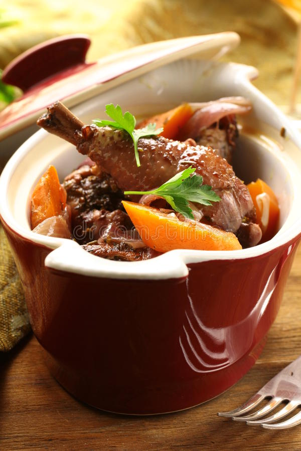 Traditional French cuisine - chicken in wine. Coq au vin royalty free stock images