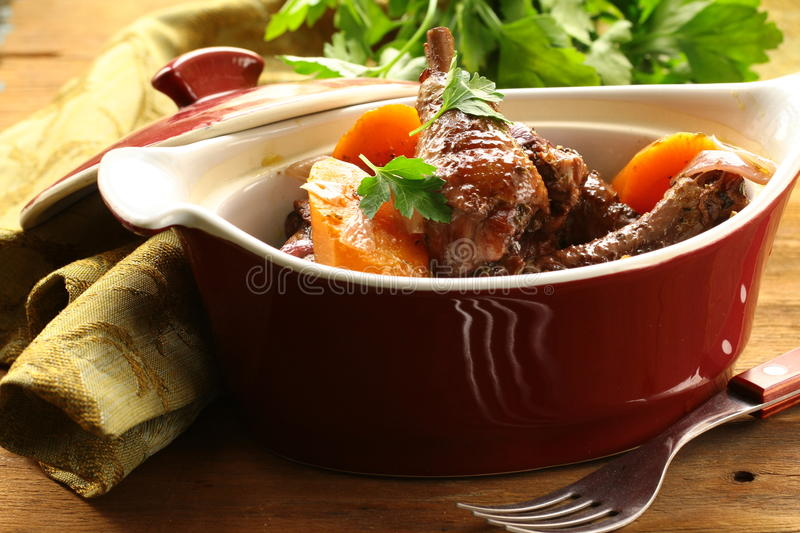 Traditional French cuisine - chicken in wine. Coq au vin stock photos