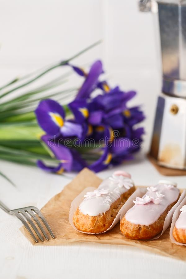 Traditional French eclairs with coffee. Good Breakfast royalty free stock photo
