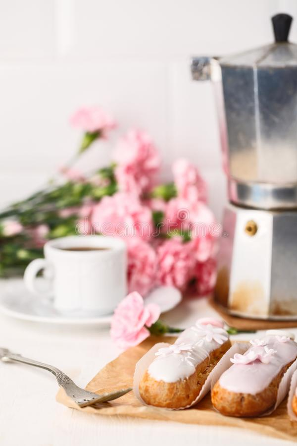 Traditional French eclairs with coffee. Good Breakfast royalty free stock photography