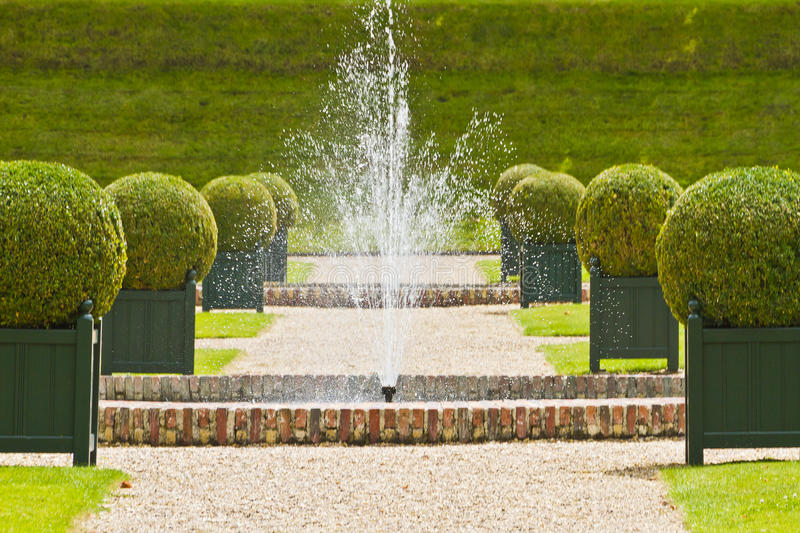 Traditional french garden. Water Garden stock images