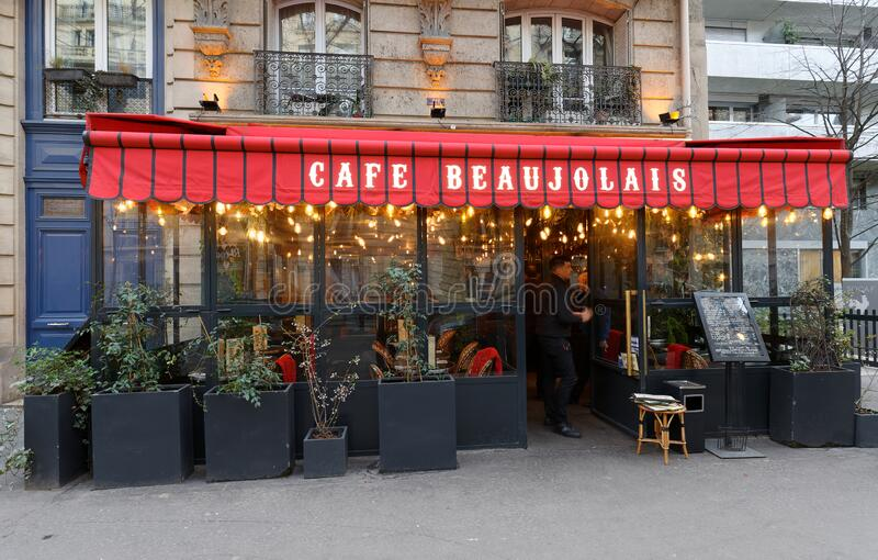 The traditional French restaurant cafe Beaujolais located near Eiffel tower in historic centre of Paris, France. stock image
