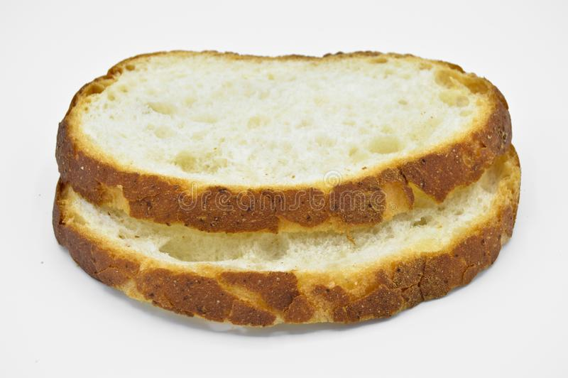 Traditional fresh and tasty white bread slice. Crust, cutting. stock photo