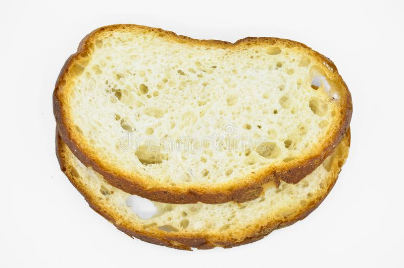 Traditional fresh and tasty white bread slice. Crust, cutting. stock photos
