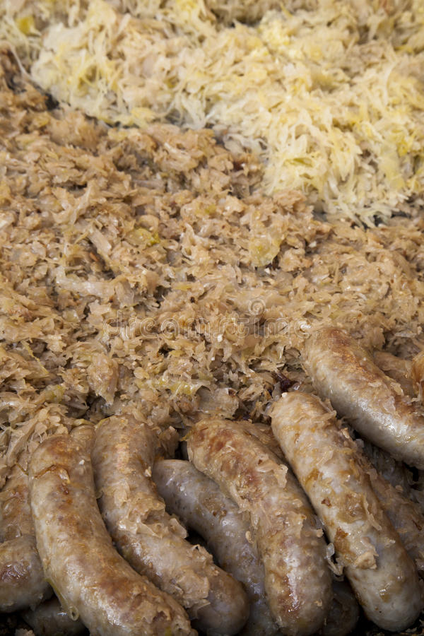 Traditional fried sausages on sauerkraut, close-up royalty free stock image