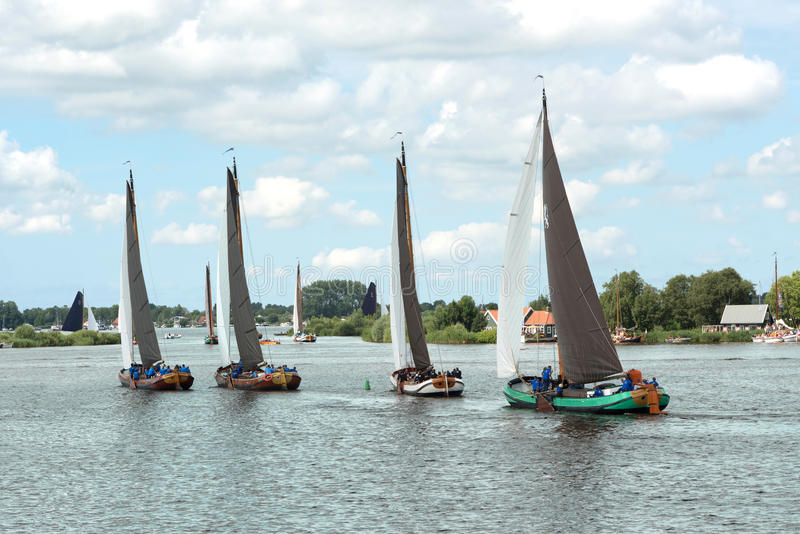 Traditional Frisian wooden sailing ships in a yearly competition royalty free stock photo