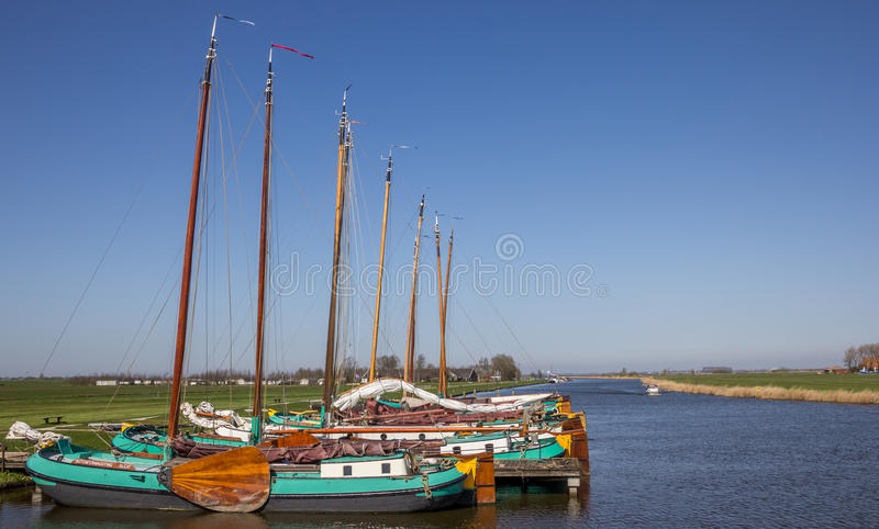 Traditional frisian wooden ships in Sloten stock photography