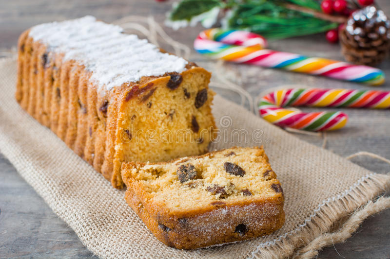 Traditional fruit cake on wood. Traditional Christmas fruit cake on wood royalty free stock photo