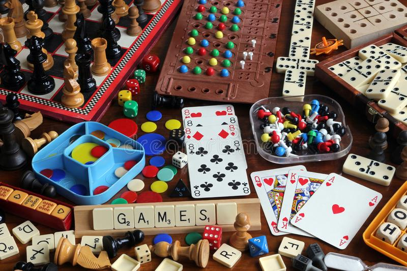 Traditional Games. Board games, Playing Cards, Dice, Dominoes, Chess and Other Games on a Table royalty free stock images
