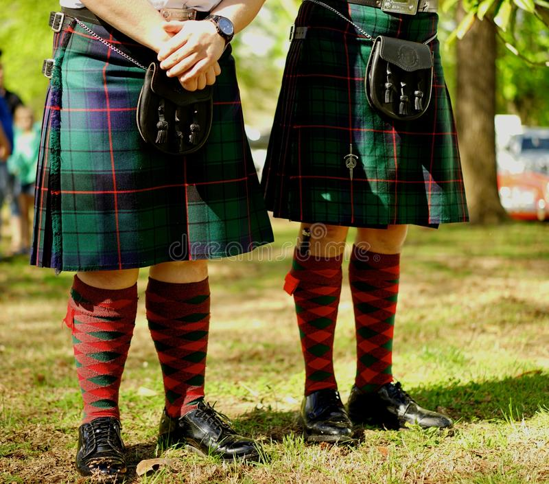 Traditional garb of Scottish bagpipers. Bagpipers in kilts and sporran are waiting their turn in a traditional bagpipe competition royalty free stock photos