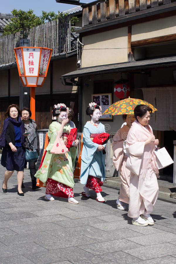 Gion Japan. Traditional geishas are walking pass on Gion street in Kyoto on April 15, 2014 in Kyoto, JAPAN. There are about 2,000 geishas in Japan today royalty free stock images