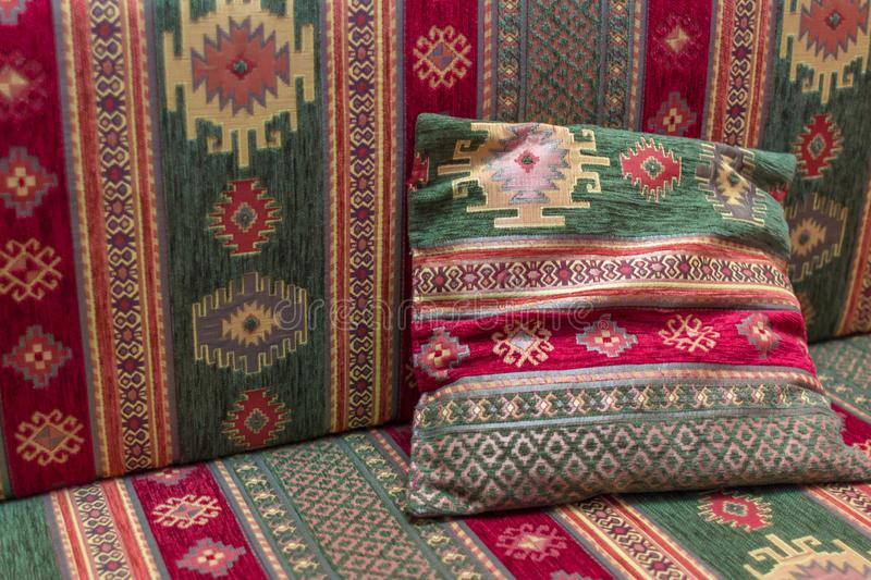 Traditional geometric pattern in turkish textile. East ornament. Turkish pillows. Traditional Asian decor. Fabric for sofa and pillows. Geometric pattern stock photography