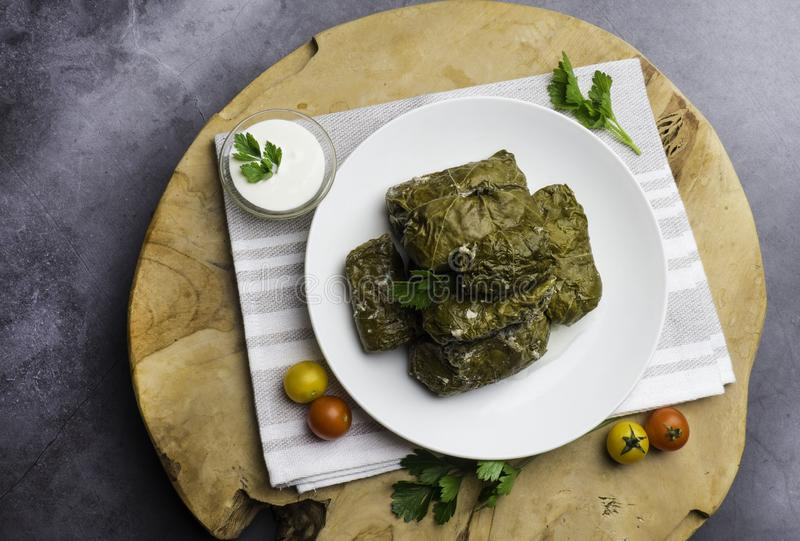 Traditional georgian dolma in grape leaves on rustic wooden table with copyspace royalty free stock images