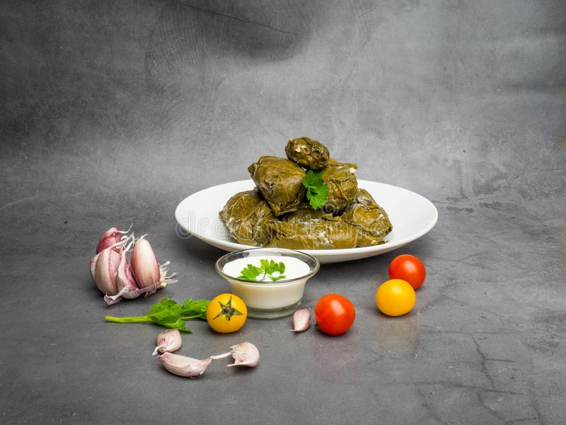 Traditional georgian dolma in grape leaves on rustic wooden table with copyspace stock photography
