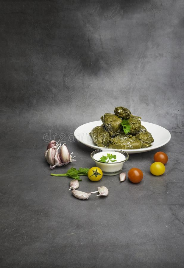 Traditional georgian dolma in grape leaves on rustic wooden table with copyspace royalty free stock photography