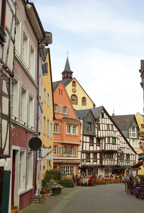 Traditional german buildings in Bernkastel-Kues on the river Mosel in Germany. View of Bernkastel-Kues on Mosel river, Germany on a sunny day royalty free stock images