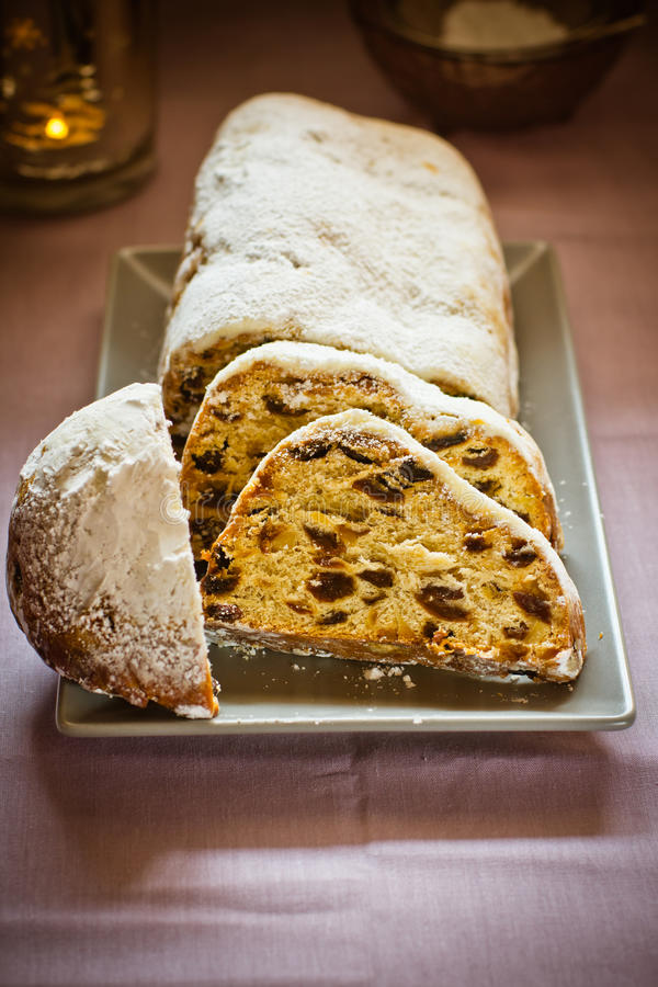 Free Traditional German Christmas Stollen With Raisins, Nuts, Candied Fruits, Sliced, Powdered On Plate, Festive Table Setting, Lit Can Royalty Free Stock Images - 93562259