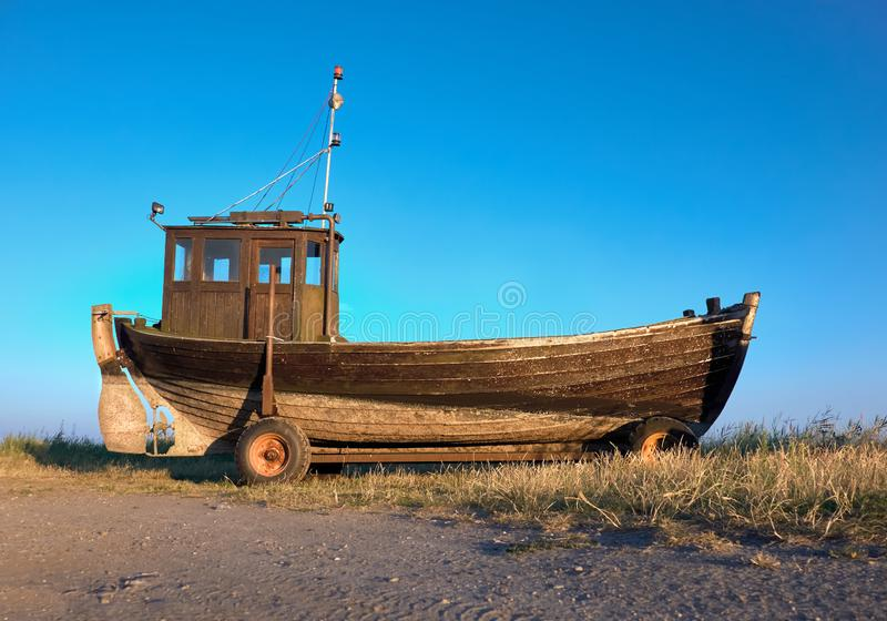 Traditional German fisherman boat on a seashore of Baltic Sea on island Rugen. Northern Germany stock photos