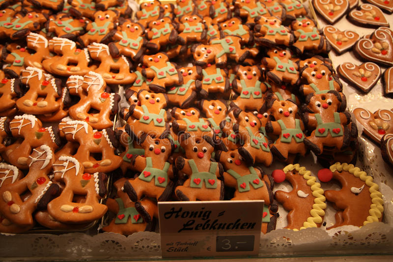 Traditional German glazed honey cookies Honig Lebkuchen in showcase at the fair at night stock images