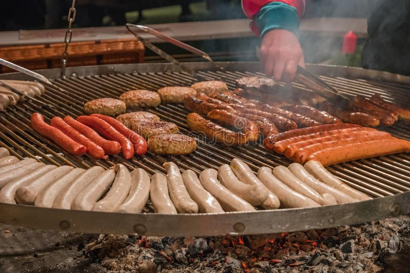 Traditional German grilled sausages at Christmas market, Germany royalty free stock photography
