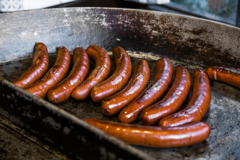 Traditional german meat sausages of beef or pork meat stock images