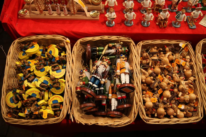 Traditional German wooden Christmas decorations in a wicker basket on a Christmas fair stock photography