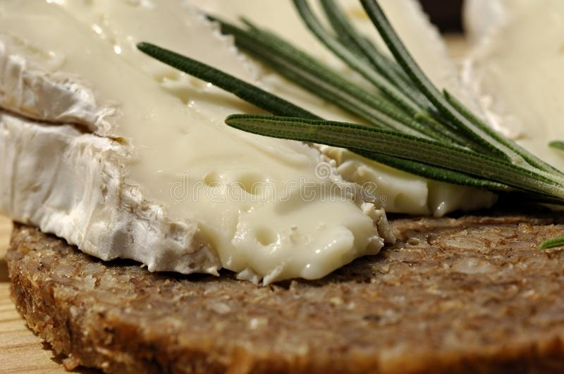 Delicious Camembert cheese with black bread. Traditional for Germany, Camenbert cheese with black whole grain bread royalty free stock image