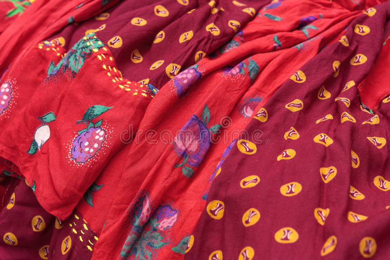 Traditional gipsy dresses fabrics. Detail of colorful traditional gipsy dresses fabrics with floral patterns. Shallow depth of field royalty free stock photos