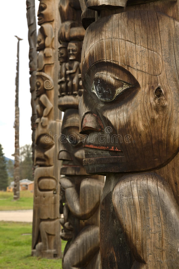 Traditional Gitxsan totem poles, British Columbia, Canada royalty free stock image