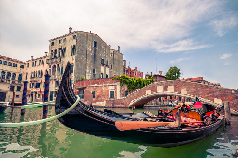 Traditional gondola and canal in Venice, Italy stock images