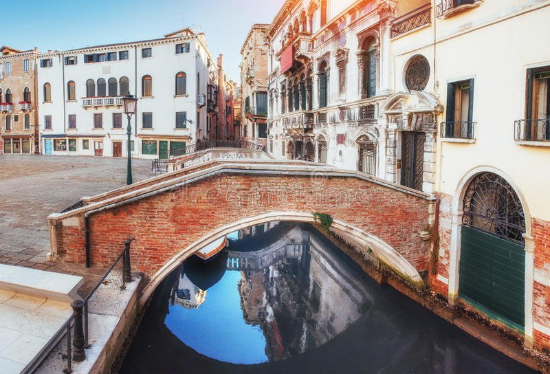 Traditional Gondolas on narrow canal between colorful historic houses in Venice Italy royalty free stock photo