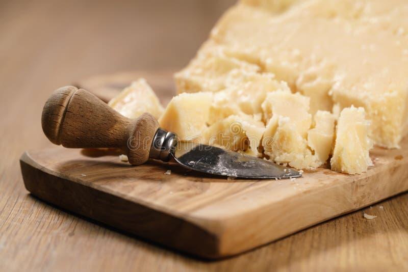 Traditional grana padano italian cheese on olive board stock photography