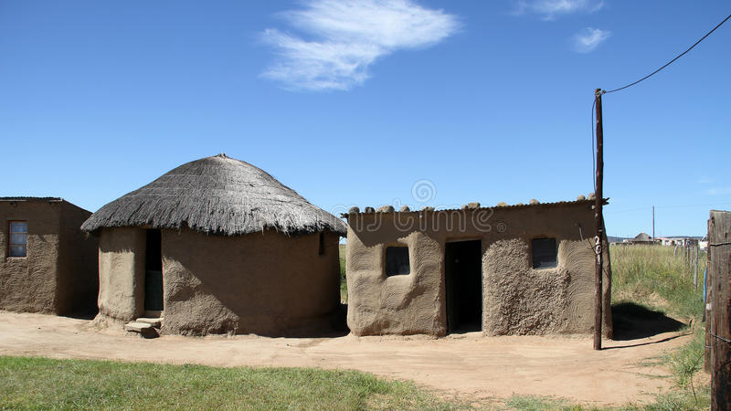Traditional grass roof hut in QwaQwa. Landscape photo of one of the many types of traditional soil and clay houses in rural area QwaQwa, South Africa stock photography