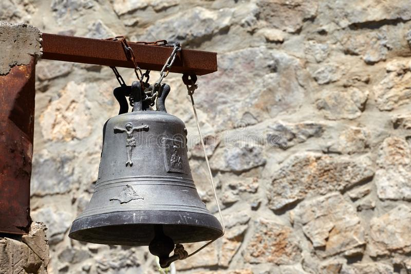 Traditional greek church bell on rusted metal pole in monastery royalty free stock images