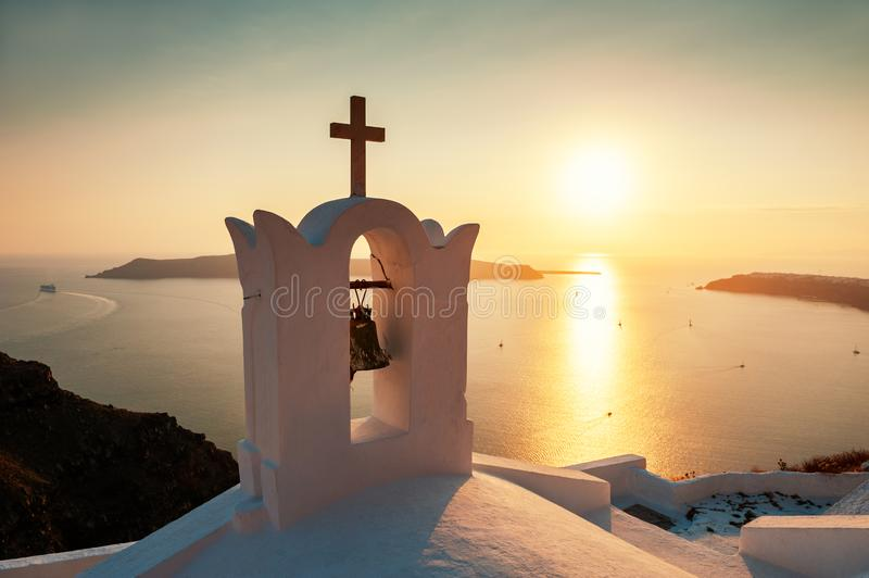 Traditional greek church at sunset on Santorini island, Greece royalty free stock images