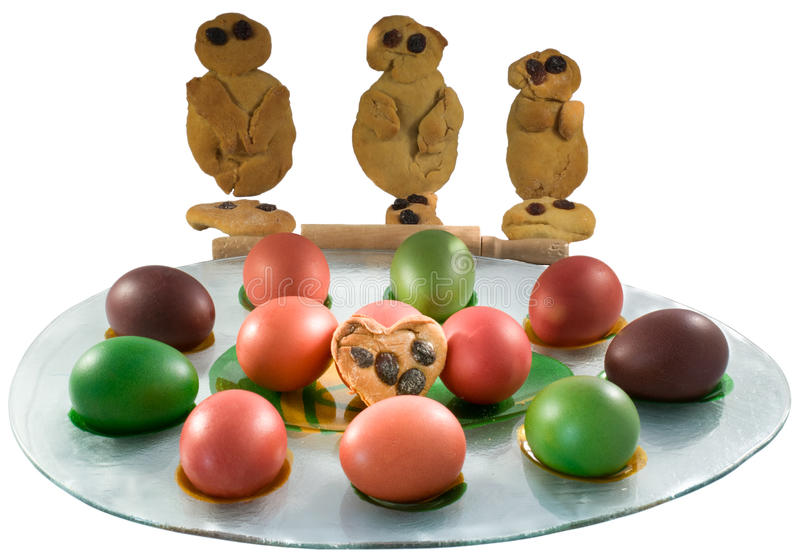 """Traditional Greek cookies """"Lazarakia"""" with Easter colored eggs. royalty free stock image"""