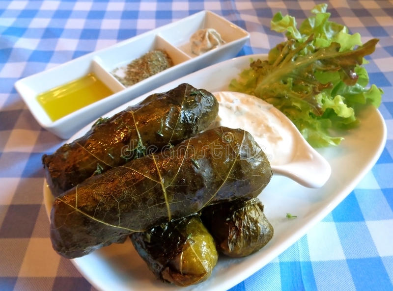Traditional Greek Dolmades, Grape Leaves Stuffed with Rice and Herbs with Yogurt Dip. Traditional Greek and Mediterranean Food Dolmades, Grape Leaves Stuffed royalty free stock photos