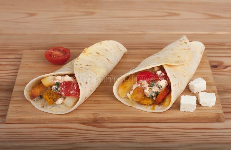 Traditional greek fast food called souvlaki or gyros in pita. royalty free stock photo