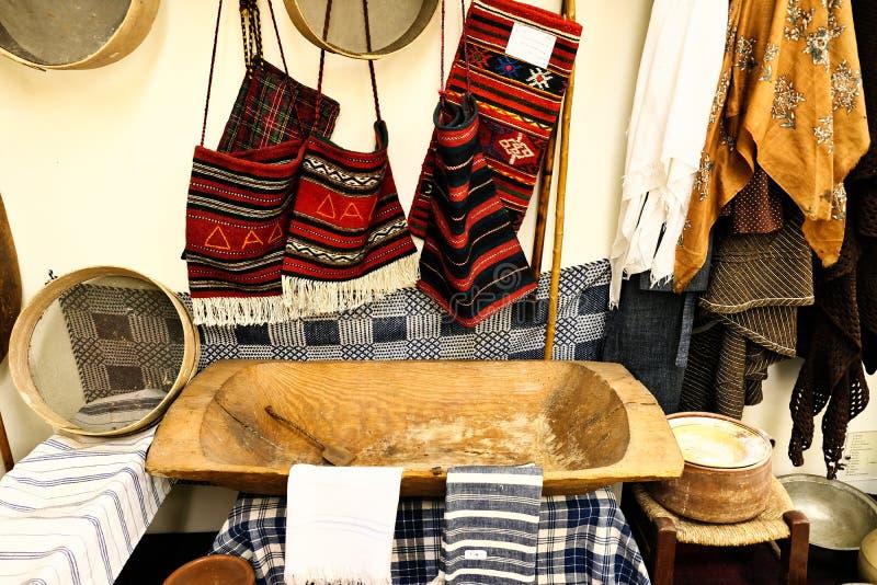 Greek Folk Art Display, Amfiklia Bread Museum, Greece. Traditional Greek handicrafts including a wooden bread dough tub and flour sieves, Bread and Folk Art royalty free stock photography