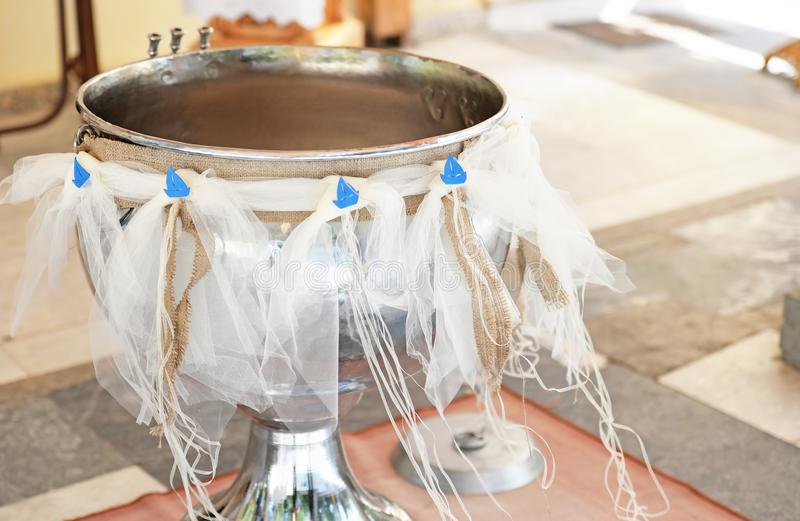 Traditional greek kolimbithra - greek Orthodox christening royalty free stock image