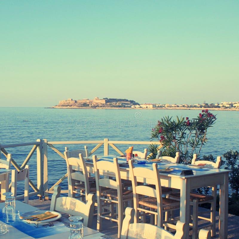 Free Traditional Greek Outdoor Restaurant On Terrace At Street Village Restaurant, Crete, Greece. Royalty Free Stock Photo - 70354155