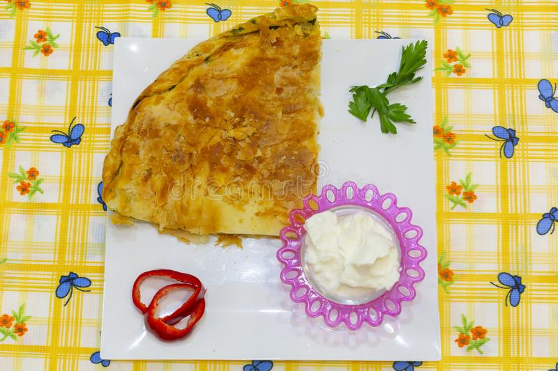 Traditional greek spanakopita - spinach pie with the greek cheese feta inside a big pan stock photography