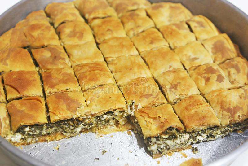 Traditional greek spanakopita - spinach pie with the greek cheese feta stock photo