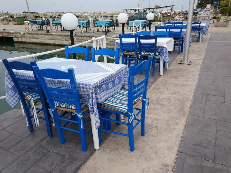 Traditional greek tavern blue tables and chairs stock image