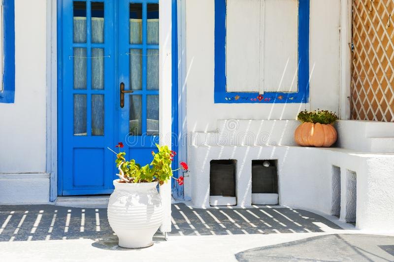 Traditional greek white architecture with blue doors and windows stock photos