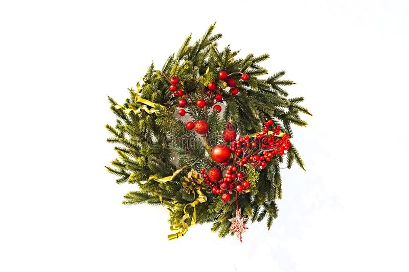 traditional green christmas wreath with holly berry isolated on white background. festive decoration, beautiful spruce wreath with royalty free stock photos