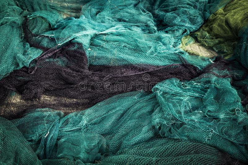 Traditional green fishing net with floats on the shore after fishing, fishing net background stock photos