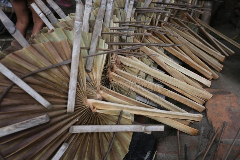Traditional hand fans are made at Cholmaid in Dhaka's Bhatara Union after bringing raw materials from Mymensingh. In Summer Bangladesh`s weather become stock image
