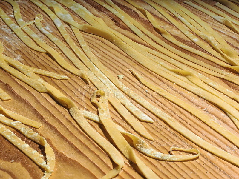 traditional hand made italian pasta called fettuccine or tagliatelle royalty free stock images