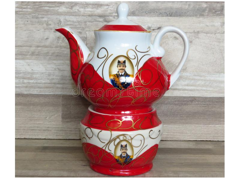 Traditional hand painted Persian Iranian teapot shah abbas and warmer in white and red. Traditional hand painted Persian Iranian teapot shah abbas and warmer royalty free stock photography